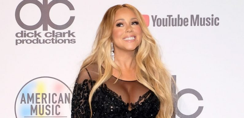 Mariah Carey Shows Ample Cleavage In Black Gown With Plunging Neckline