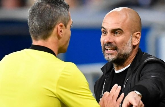 Man City boss Pep Guardiola held back by assistant Mikel Arteta as he blows top at ref over Leroy Sane penalty incident