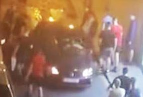 England fans clash with riot police after vandalising cars in rowdy night of boozing before Spain match