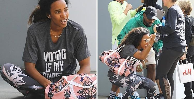 Kelly Rowland looks knackered and collapses on the ground after a gruelling spin class in LA