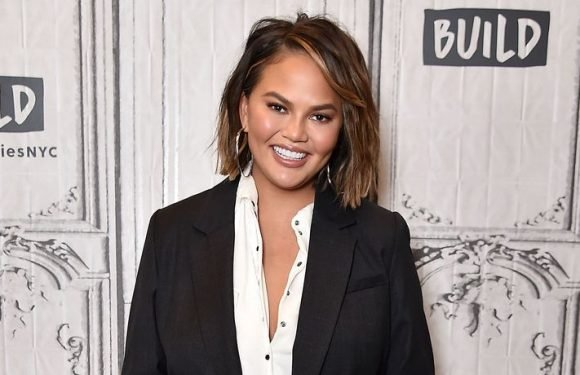 Chrissy Teigen Shows Off Her Curves In Sexy Beach Photo Shoot