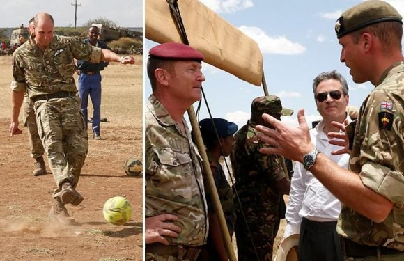 Prince William plays football with schoolkids while visiting the Irish Guards in Kenya