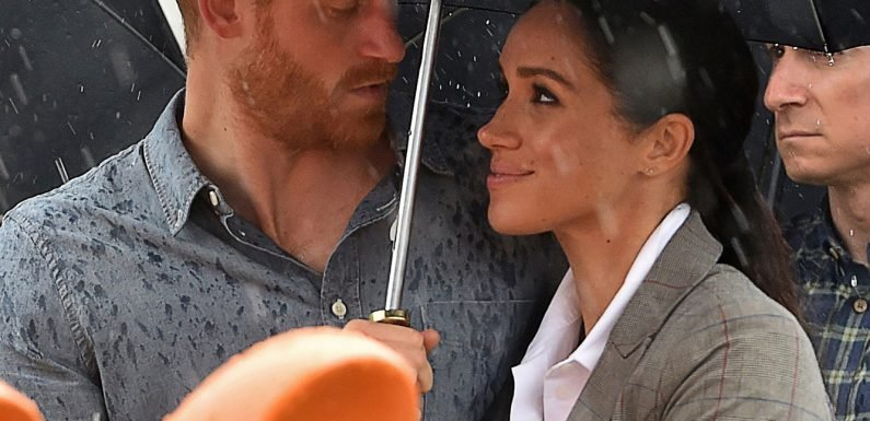 3 Photos That Prove Meghan Markle and Prince Harry Can Make Standing Under an Umbrella Romantic
