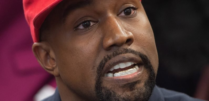 Kanye West hops on table at Apple store, gives 'keynote' speech