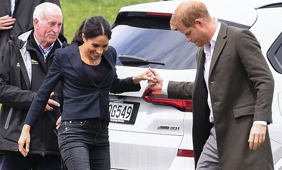 Meghan Markle & Prince Harry Break Royal Protocol & Indulge In Adorable PDA While Rocking Jeans