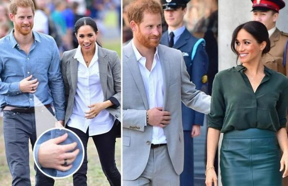 Prince Harry baffles fans by wearing a black ring on his right hand in Australia… so is it a gift from Meghan?