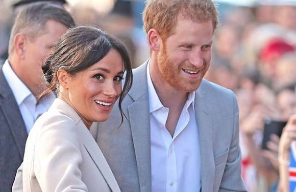 Prince Harry Kisses a Fan With Meghan Markle Nearby