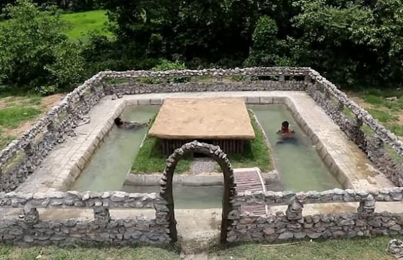 Two men build swimming pool in just two weeks using primitive tools