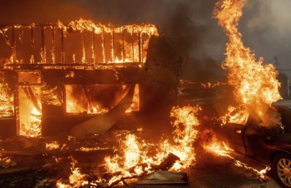 California wildfire leaves town in ruins as nearly quadruples in size