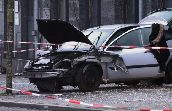 Germany crash leaves one dead and eight hurt after 'suicide driver' ploughs into crowd at a bus stop