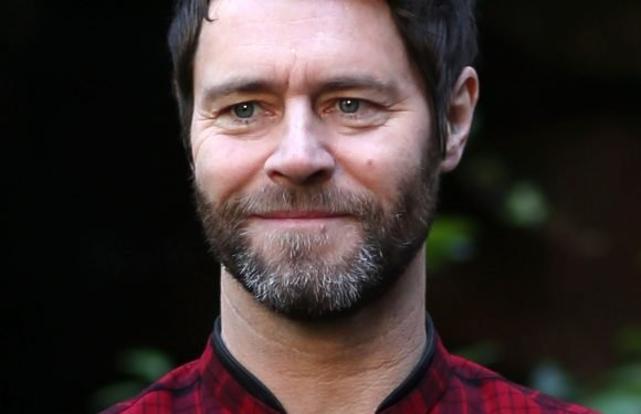 Who is Howard Donald married to, how many children does the boyband star have and how long has been in Take That?