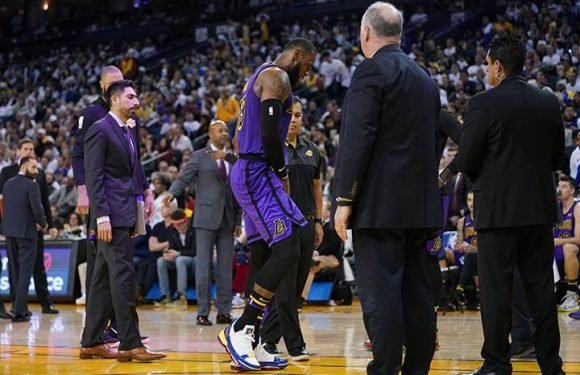 Lakers lose LeBron James to groin injury, but defeat Warriors