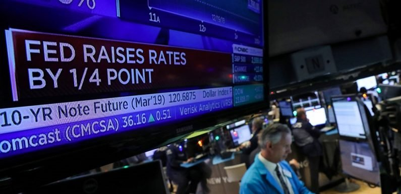 Federal Reserve raises interest rates, signals fewer hikes ahead