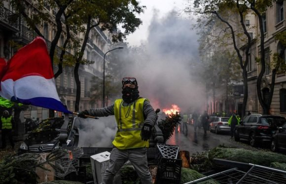 Paris forced to shut down as scores injured in 'yellow vest' fuel riots