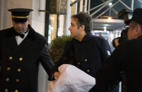 Michael Cohen arrives home from hospital with arm in sling