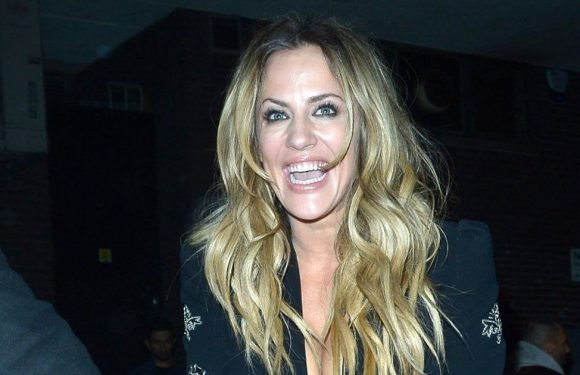 Caroline Flack gaffer tapes her shoes as she stumbles out of Brits