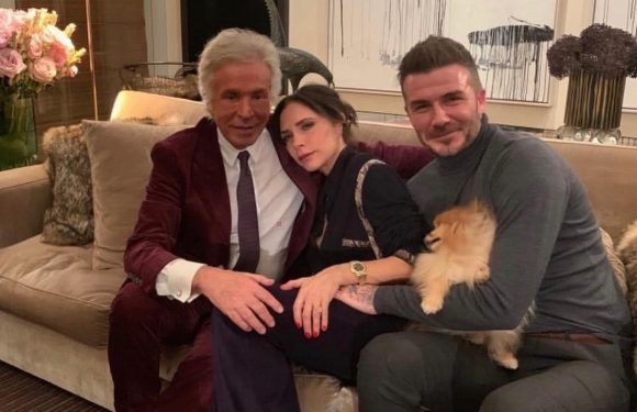 David and Victoria Beckham share a rare cuddle on a sofa at fashion party