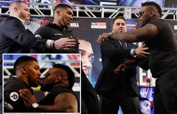 Joshua held back after Miller sent him flying before rowing with heckler in heated presser