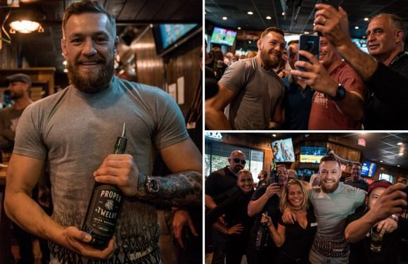 Conor McGregor goes out of way to take selfies with fans after UFC star's arrest for 'smashing man's phone'