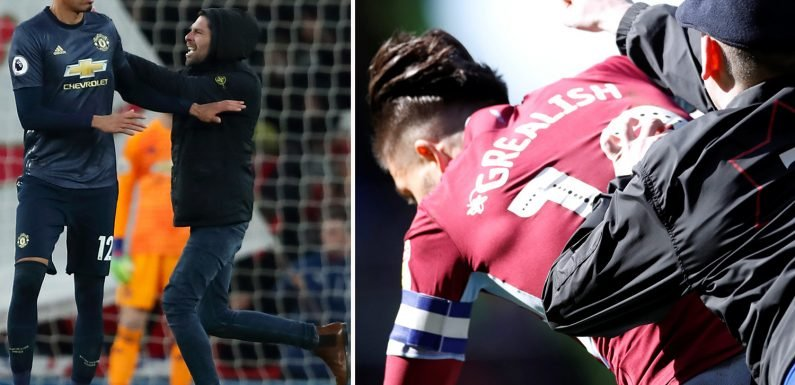 Shearer warns football ace could be killed in pitch invader attack as Grealish and Smalling both accosted by 'fans'