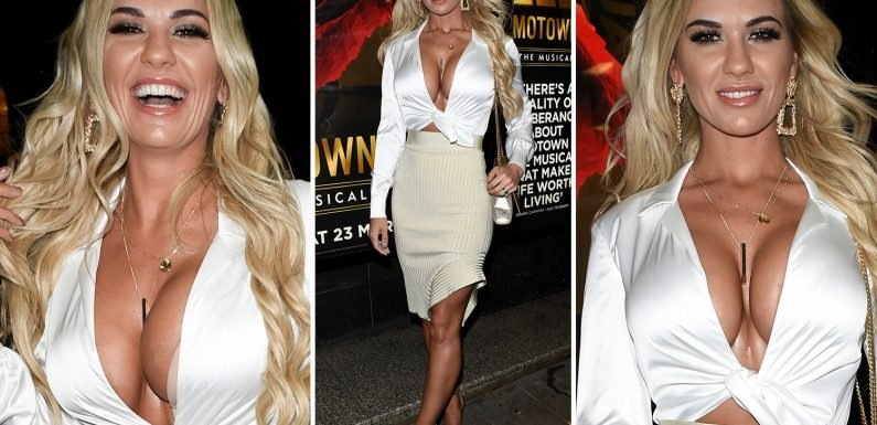 Christine McGuinness shows off her cleavage in plunging silk crop top