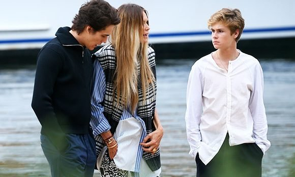 Elle Macpherson & Her Handsome Sons, Cy, 16, & Flynn, 21, Pose On Paddle Boards For Family Shoot