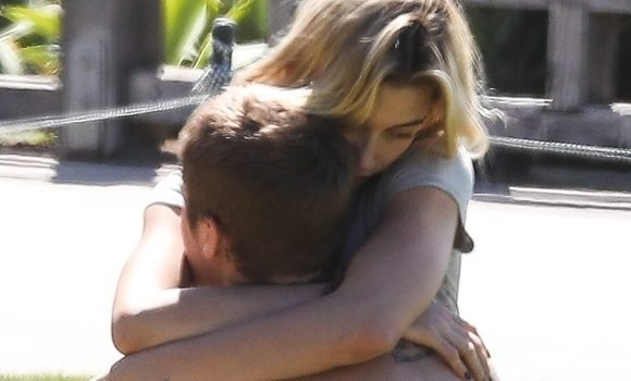 Hailey Baldwin Hugs Husband Justin Bieber As He Sunbathes In A Park – See Pics