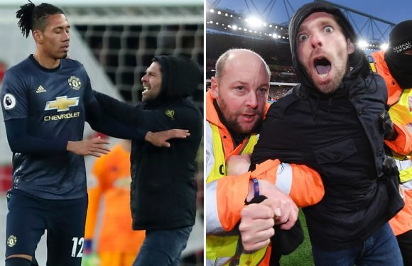 Pitch invader arrested for common assault at Arsenal during Man Utd clash