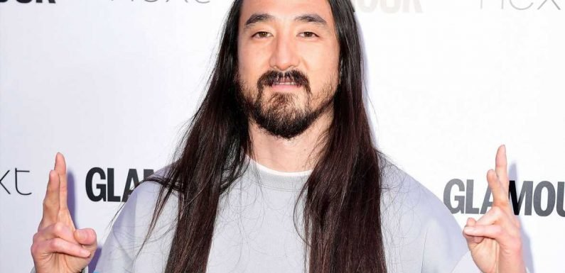 DJ Steve Aoki distracts fans with huge bulge as he strips down to tight purple pants on Instagram
