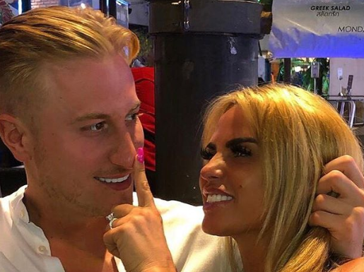 Katie Price sparks engagement rumours as she flashes huge diamond ring in Thailand with Kris Boyson