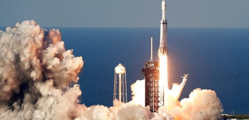 SpaceX successfully launches Falcon Heavy, world's most powerful rocket, for paying customer
