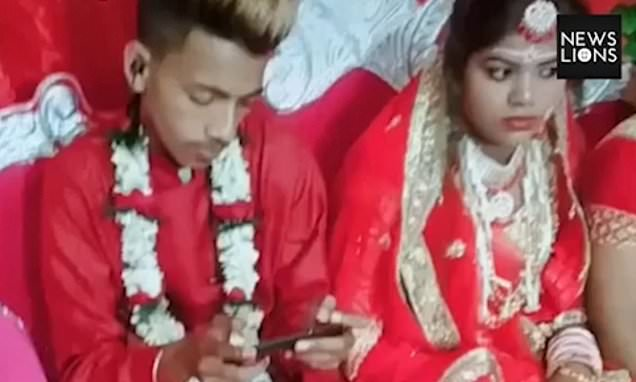 Least romantic groom ignores his bride and plays on a games console