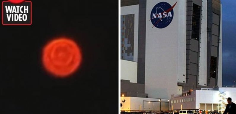 Blazing 'objects' spotted hovering above NASA's Kennedy Space Centre in bizarre footage