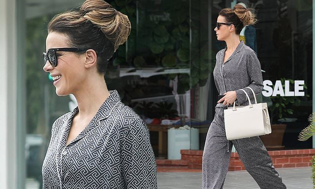 Kate Beckinsale cuts a chic monochrome co-ord  on shopping  trip