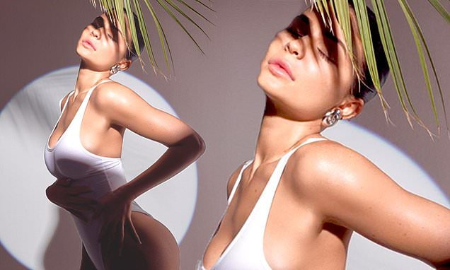 Kylie Jenner bares all in skimpy white swimsuit
