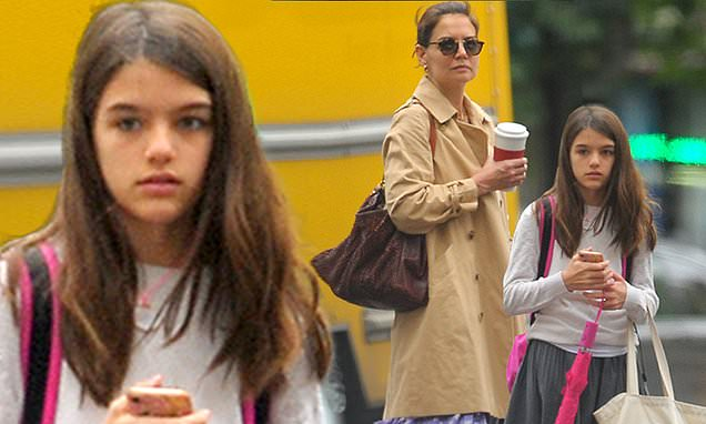 Suri Cruise is all grown up! Katie Holmes' teenager checks cellphone