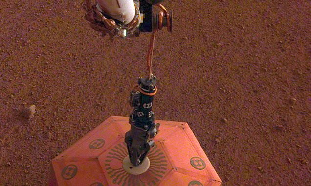 NASA robot will try to rescue an instrument trapped in Mars surface