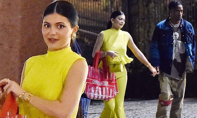 Kylie Jenner dazzles in yellow as she holds hands with Travis Scott