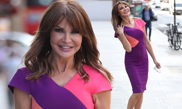 Lizzie Cundy, 50, catches the eye in a figure-hugging pencil dress
