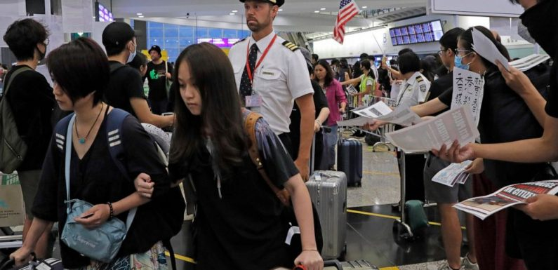 The Latest: Hong Kong airport cancels all departing flights