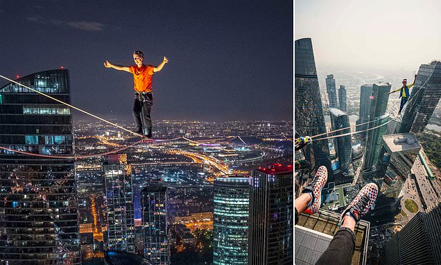 Dare devils walk across rope 1,000ft above Moscow to set a new record