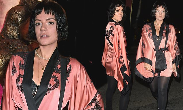Lily Allen sets pulses racing in a pink kimono jacket at LFW event