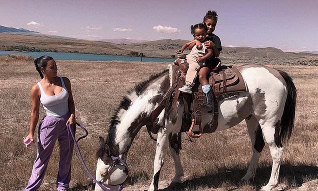 Kim Kardashian helps North and Chicago on a horseback ride in Wyoming