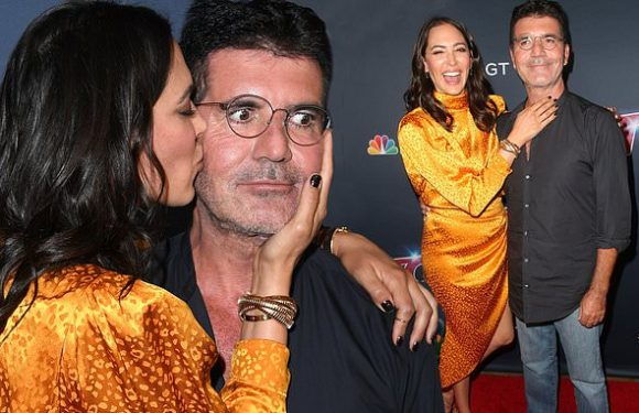 Simon Cowell is showered with kisses by girlfriend Lauren Silverman