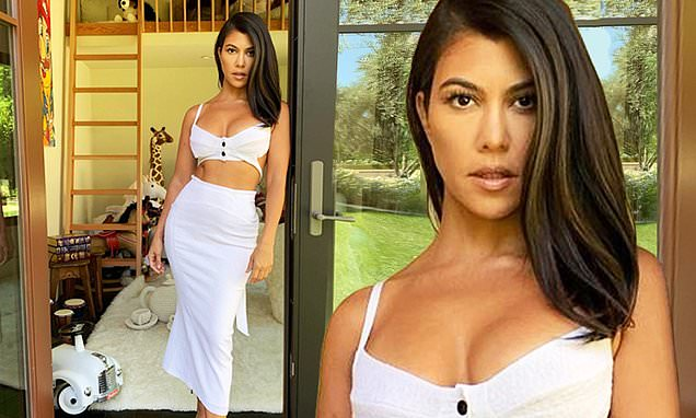Kourtney Kardashian flaunts her figure in white bra on playhouse tour