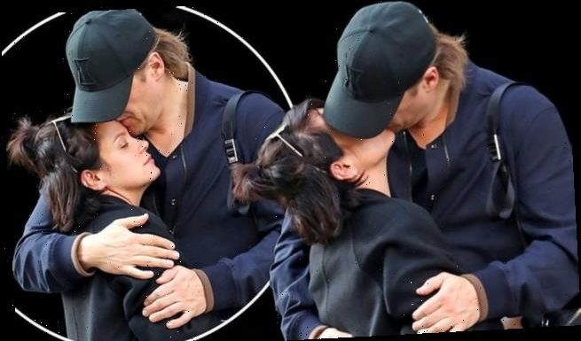 Lily Allen shares passionate kiss with David Harbour on cosy stroll