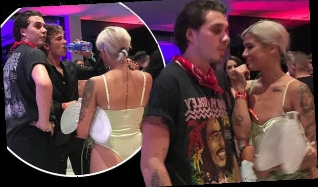 Brooklyn Beckham gets close to a mystery blonde at Halloween bash