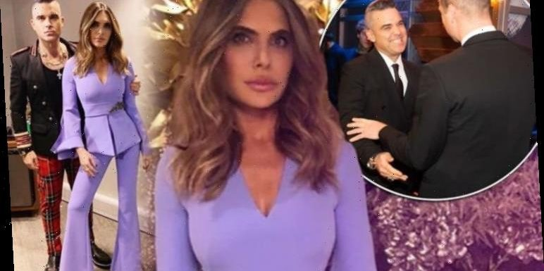 Ayda Field catches the eye in purple as husband Robbie Williams meets Prince William