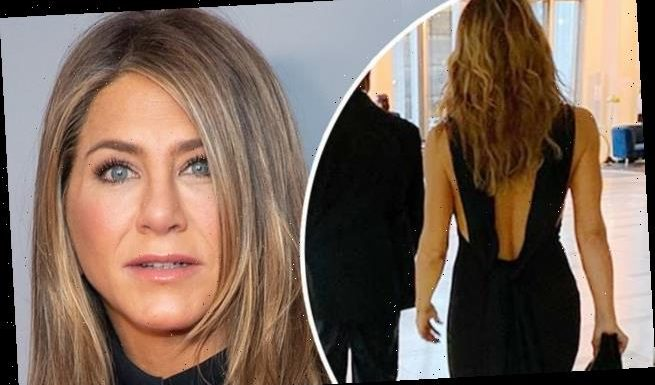 Jennifer Aniston, 50, shows off her toned back in a chic gown