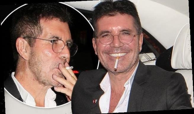 Simon Cowell enjoys cigarette and bottle of his favourite skinny beer